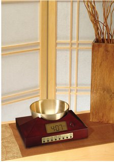 Zen Timepiece, a bowl/gong alarm clock and timer in cherry finish