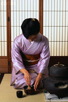 Japanese woman performing tea ceremony in seiza sitting position
