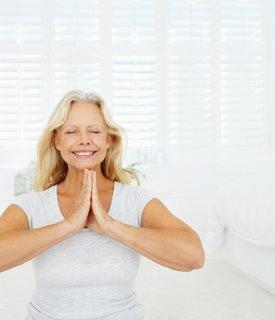 meditating mature lady - smiling